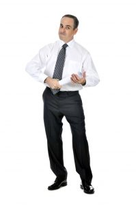 Business man in suit holding rolled up paper